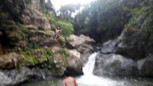 cliffjumping into a beautiful river in puerto rico