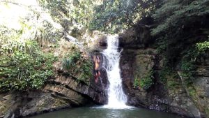Jumping in a beautiful waterfall in puerto rico