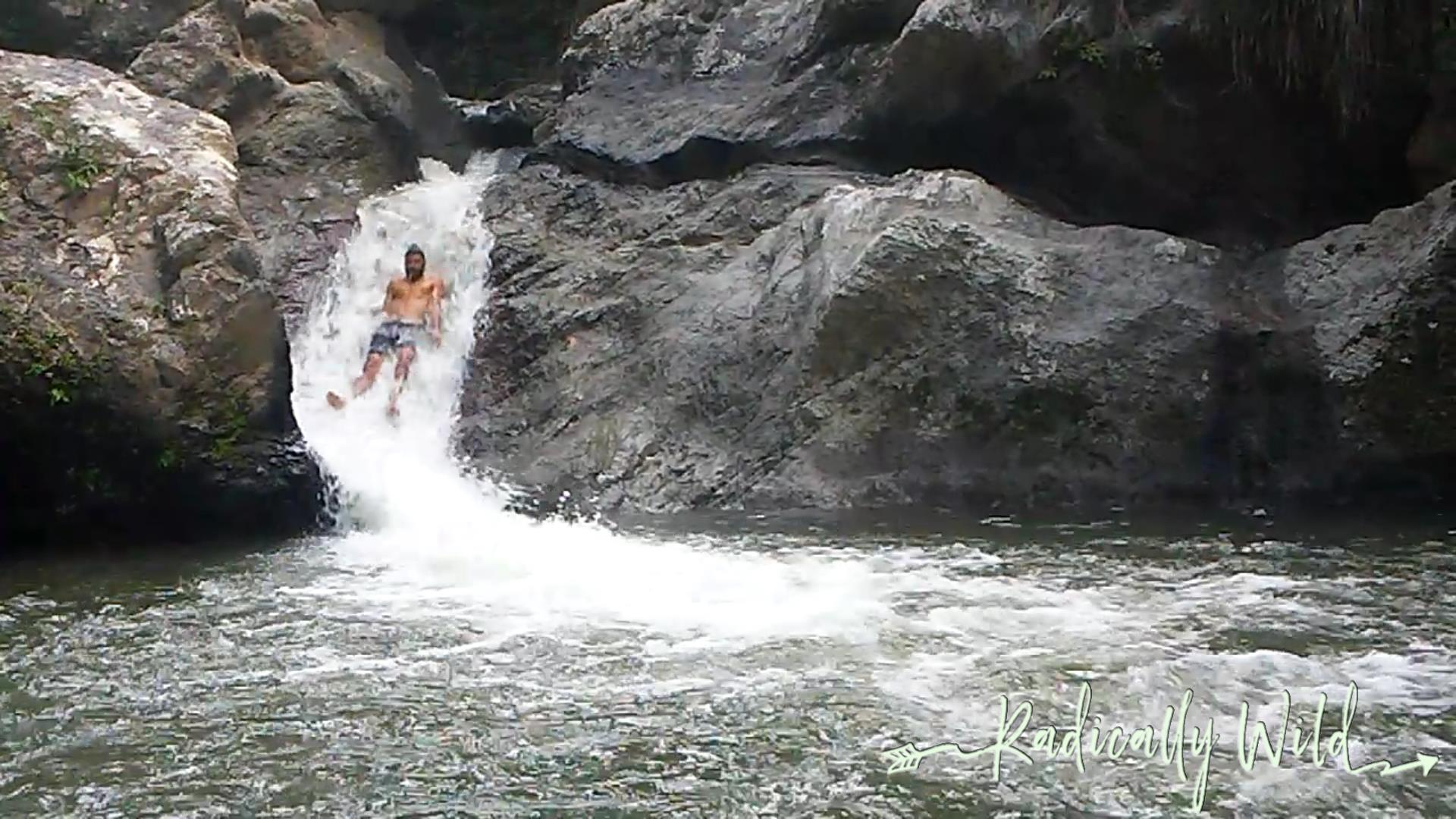 sliding down a waterfall